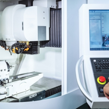 maintenance-engineer-controlling-industrial-robotic-holding-automotive-part-with-cnc-machine_73899-1257-56c97dc6f12a45aef35eb96d7511400a.jpg